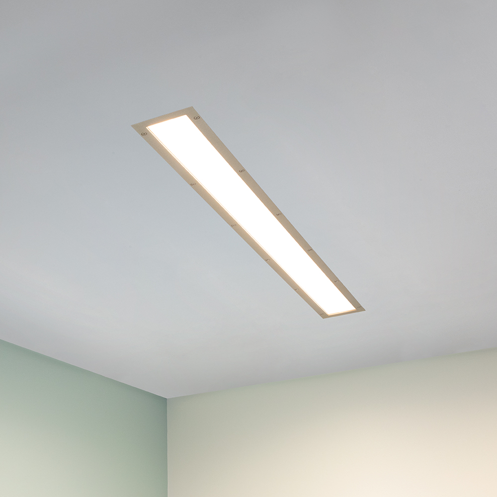 A flush-mounted linear luminaire with diffuse luminosity and a rectangular frame