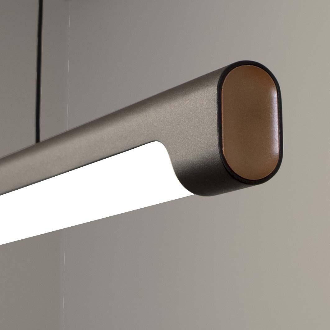 Nacelle linear LED pendant unique concave end cap detail in black and gold paint