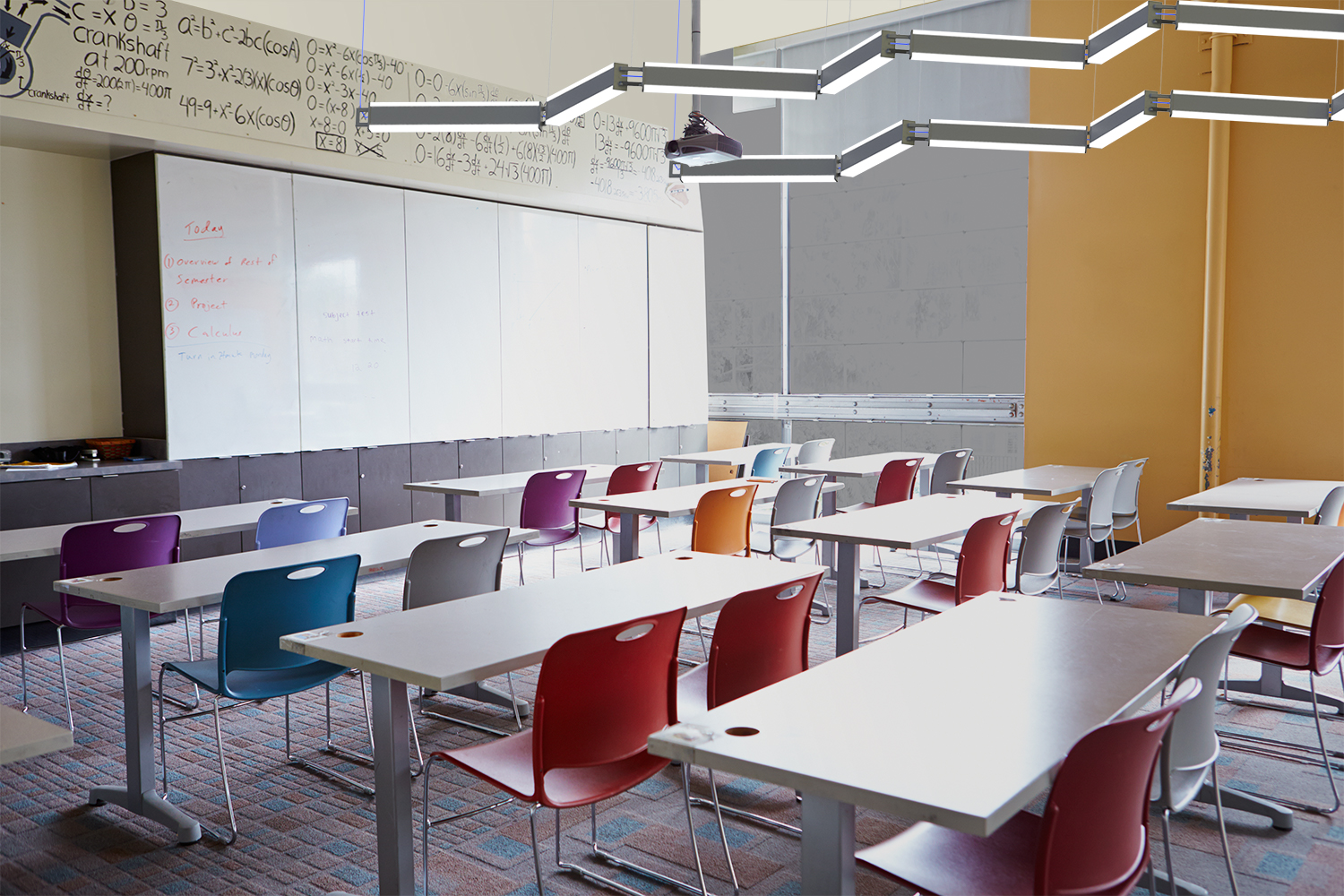 Catena linked linear pendants in white light disinfection mode in a classroom