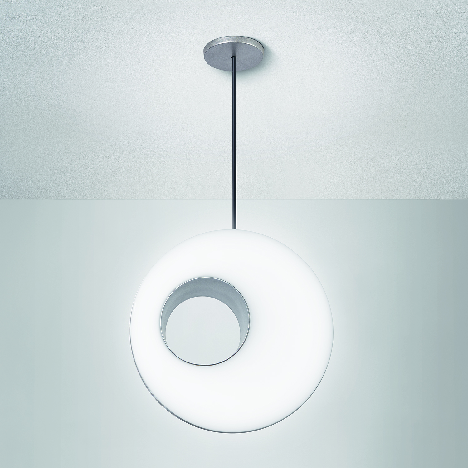 Peek, the retro modern contemporary pendant, shown straight on to display the asymmetric void.