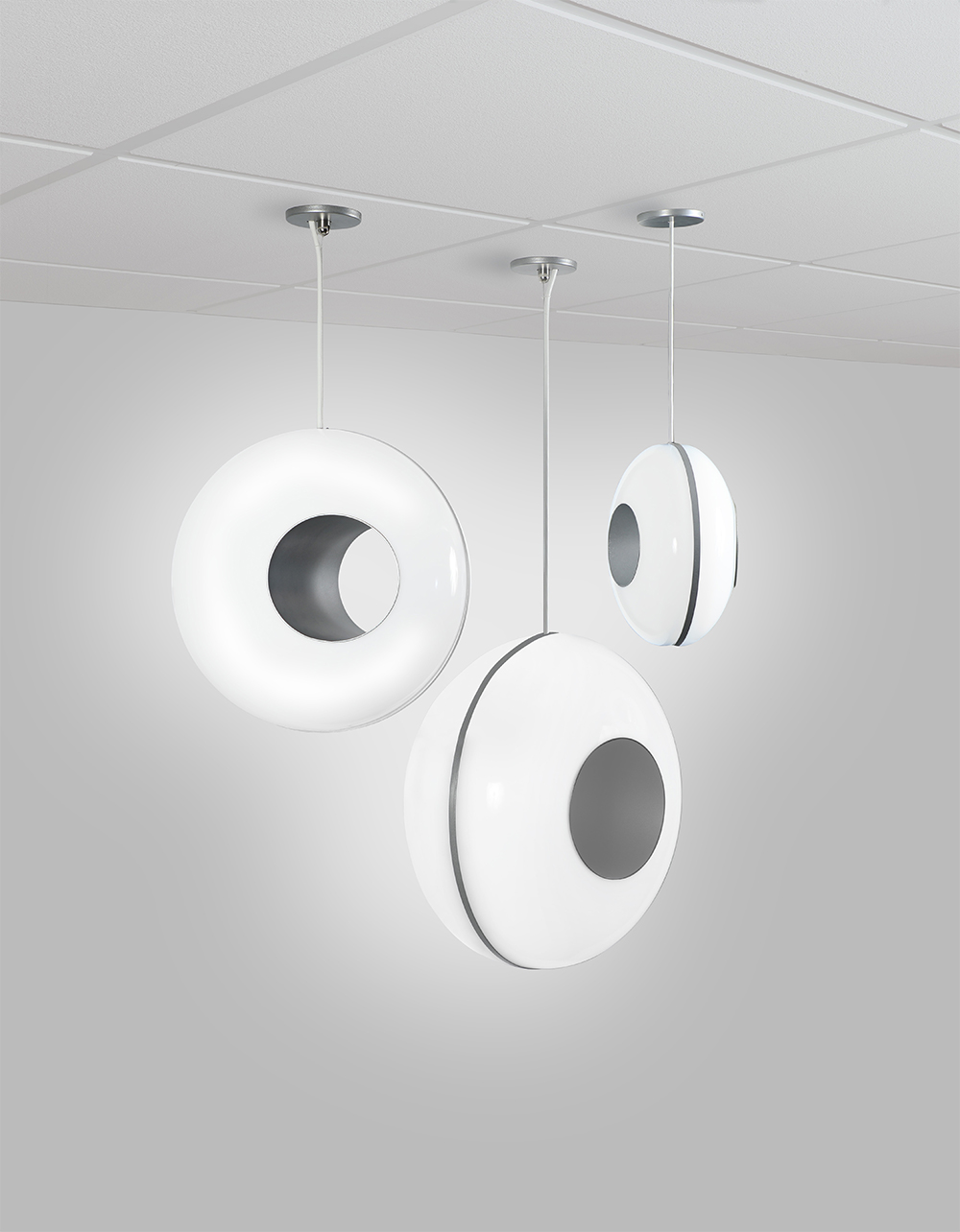 All three sizes of the Peek contemporary pendants, mounted together in a cluster.