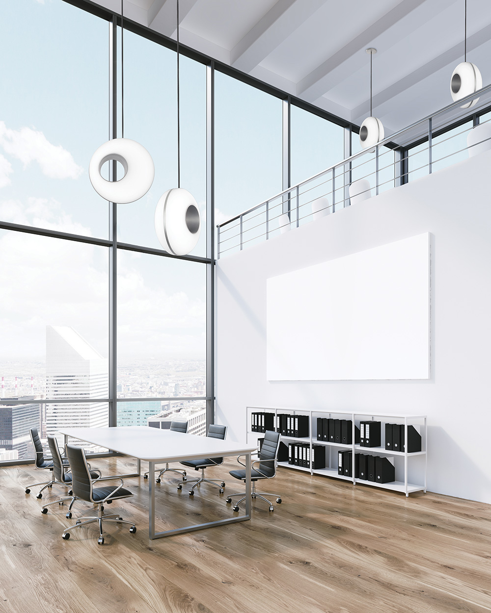 Peek luminaire models in multiple sizes in an open workplace, showing how the contemporary pendants can complement one another