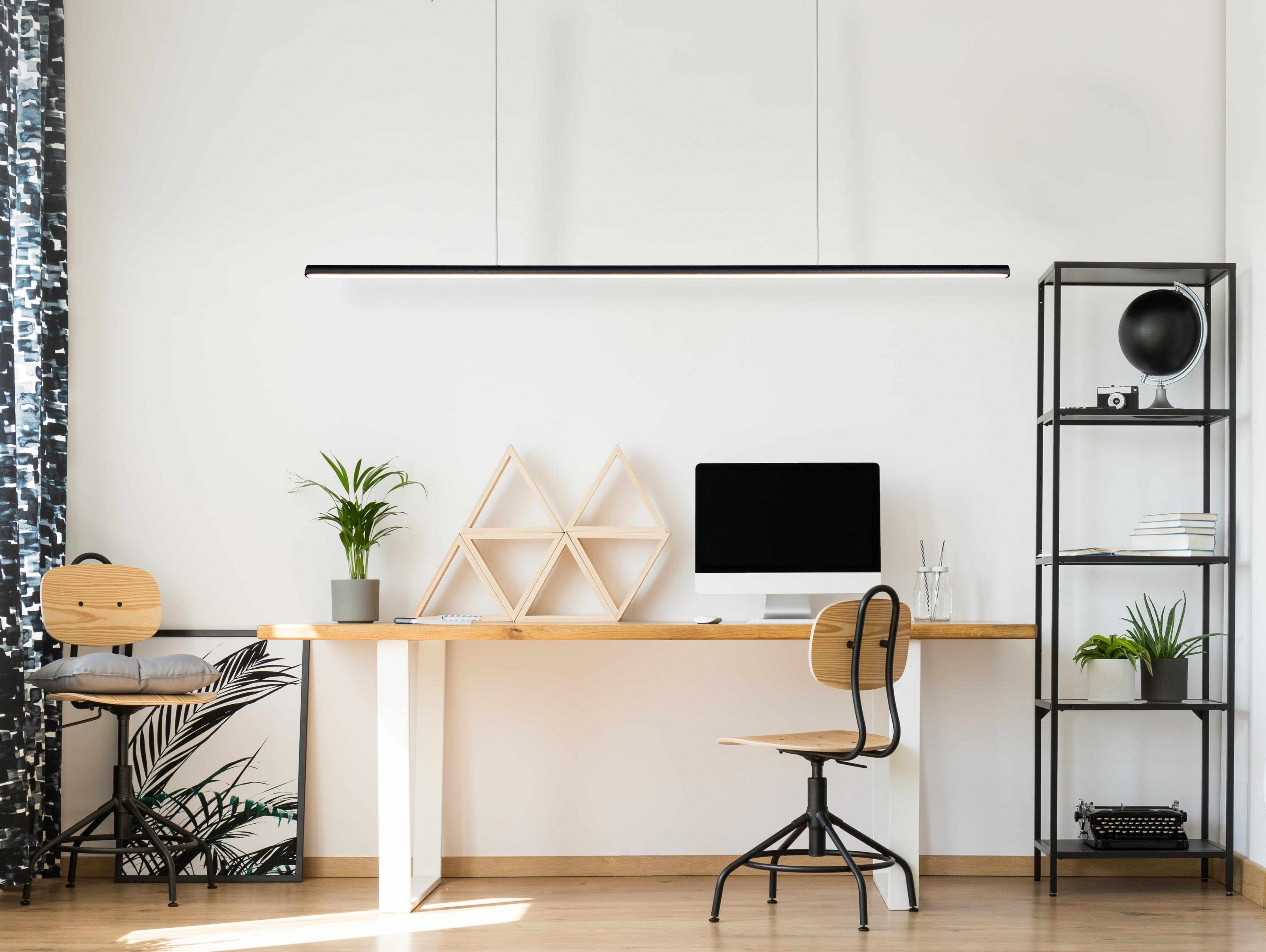 Led linear pendant used in a modern office setting