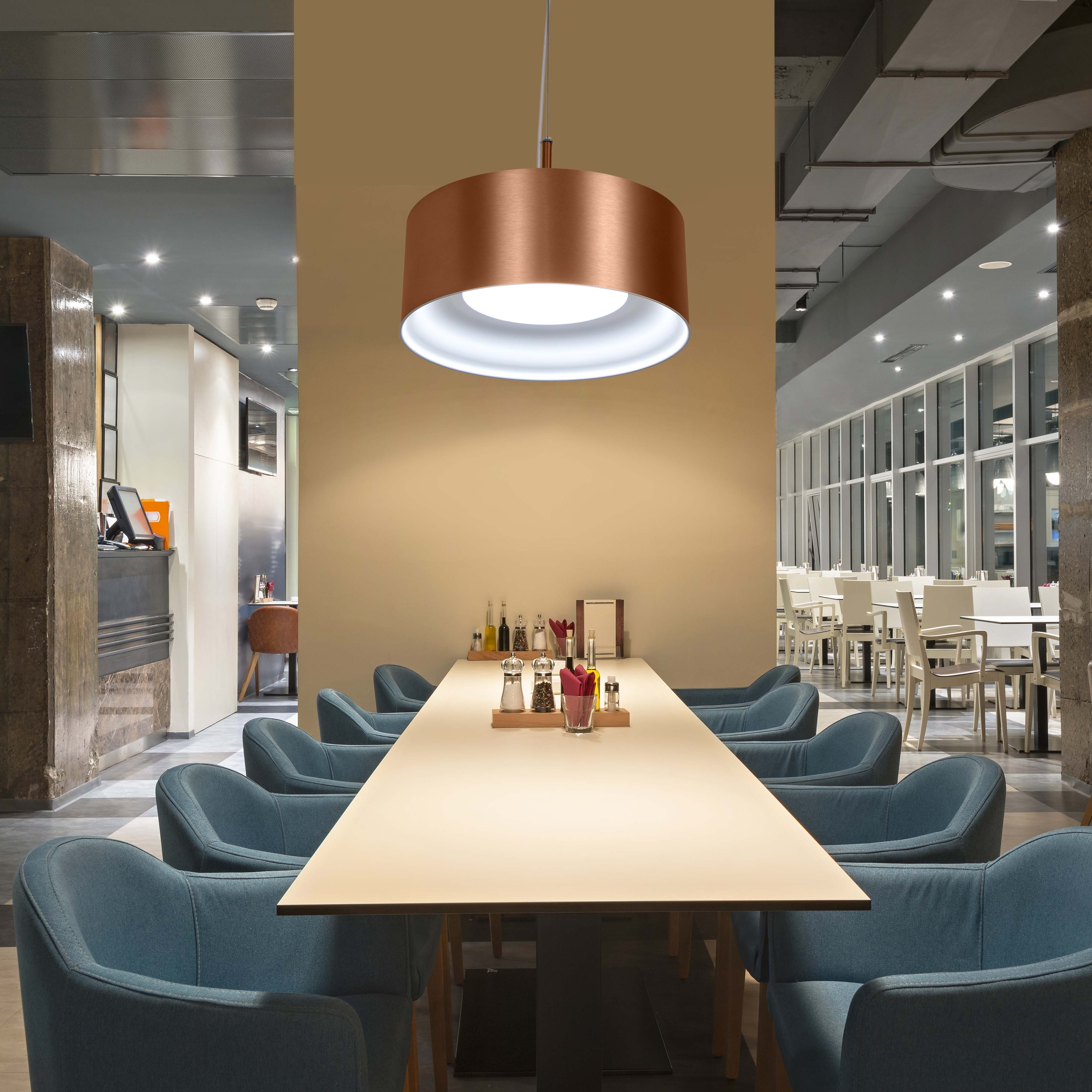 Riff two-tone led drum pendant hanging over table