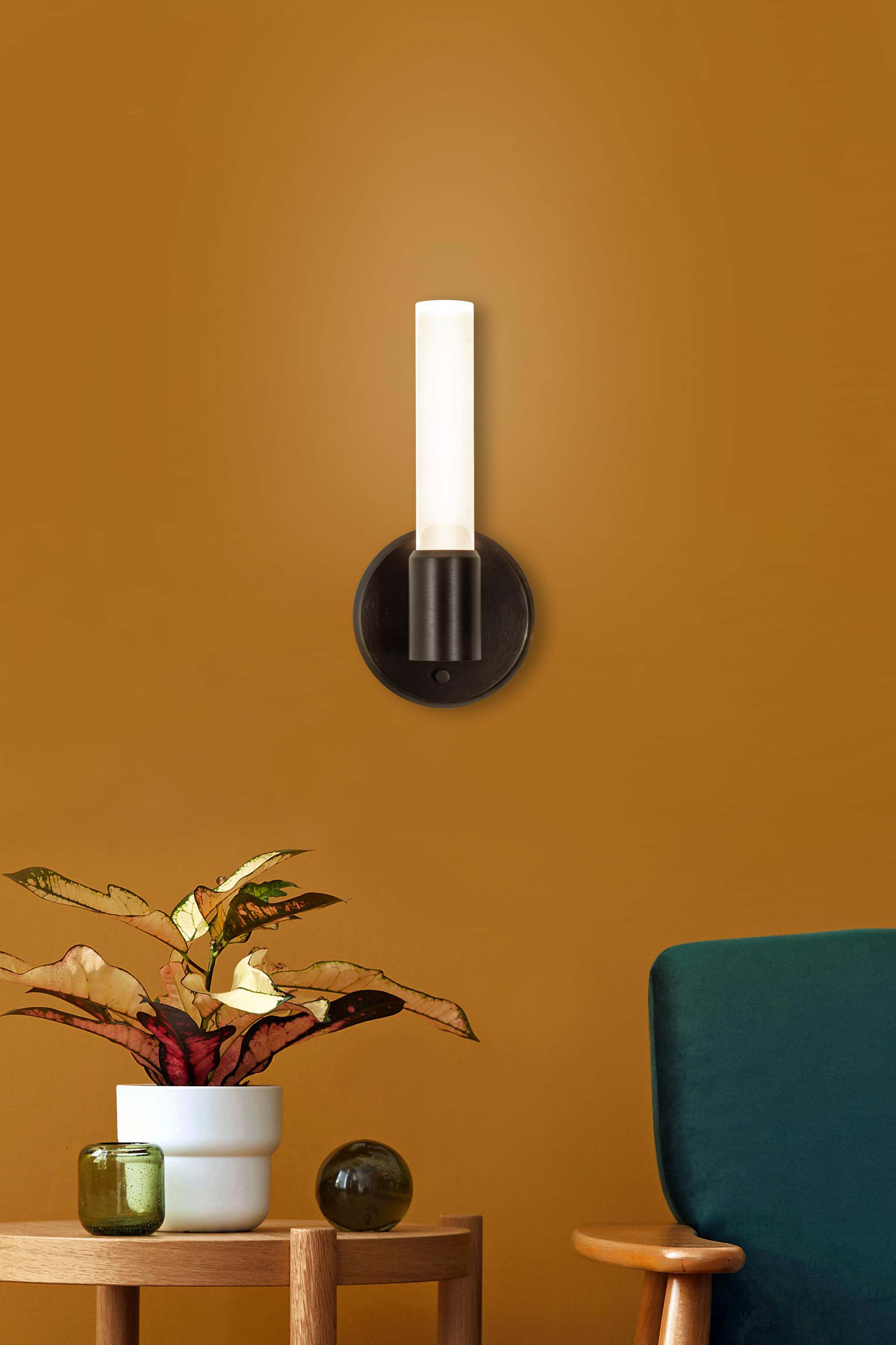 Theo single candelabra wall sconce in brushed brass