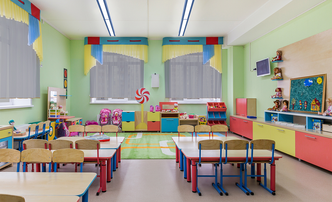 Latitude direct/indirect linear surface mounted ceiling fixtures in a bright classroom