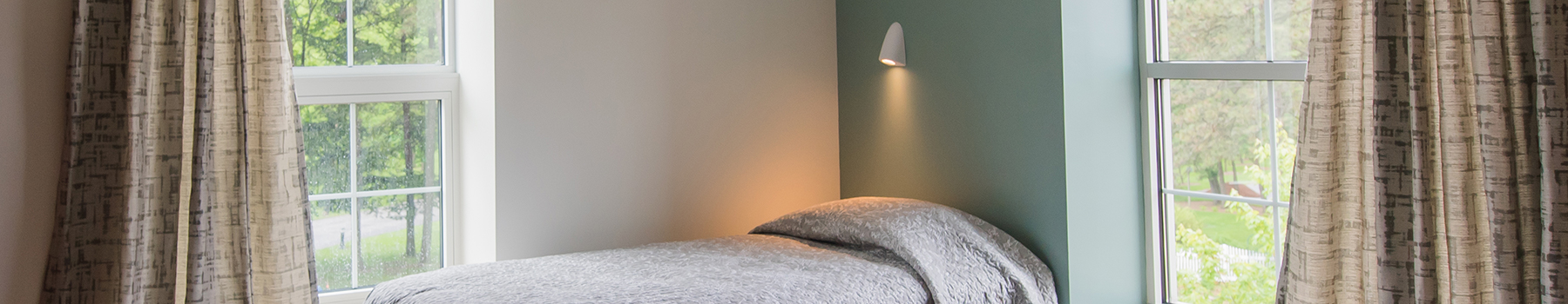 Behavioral health task light in an airy bedroom with windows