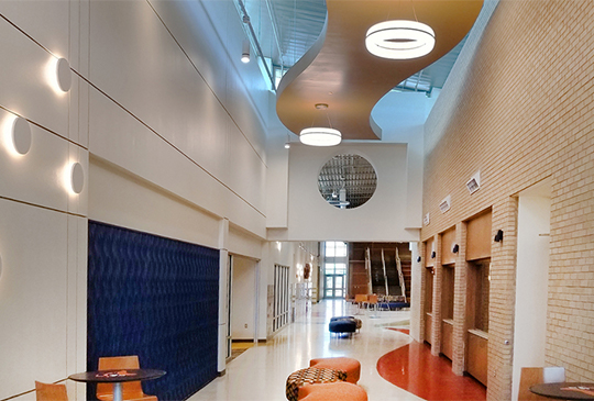 Meridian Round pendants in an elementary school corridor