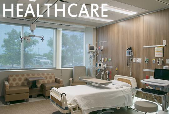 Visa Lighting overbed fixtures in a healthcare patient room