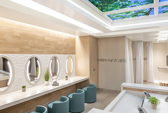 Sole lighted mirrors in a behavioral health spa bathroom