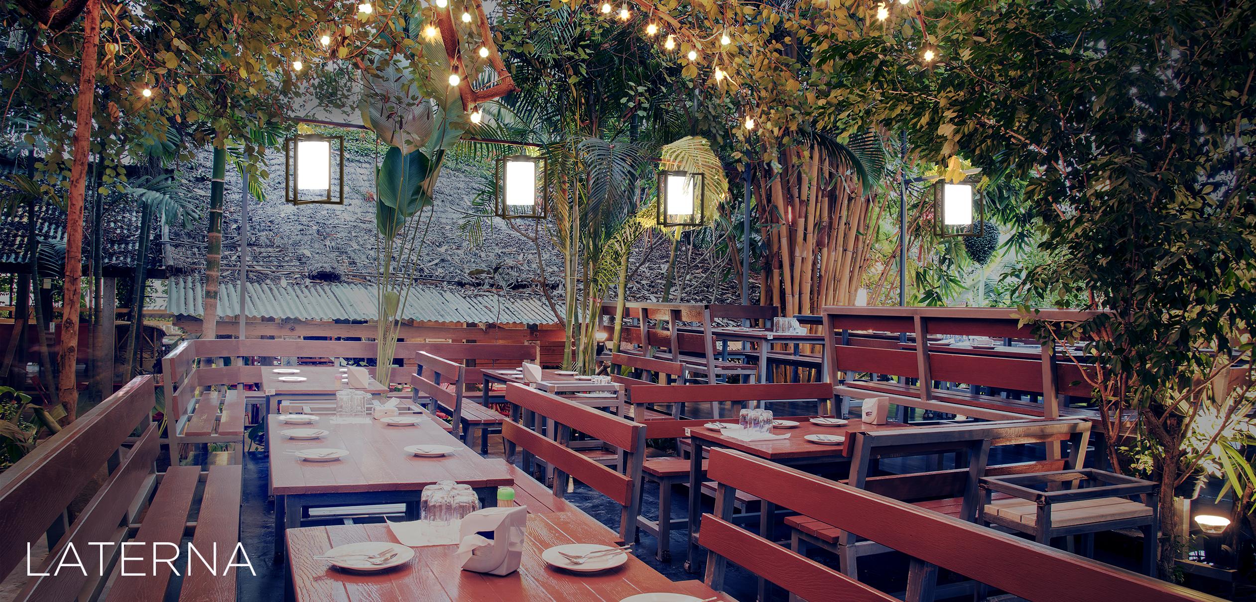 Laterna catenary lantern pendants in an outdoor dining area