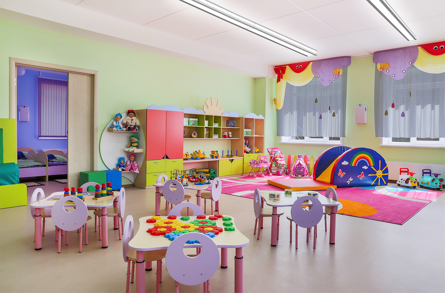 Latitude direct/indirect linear surface mounted ceiling fixtures in a bright daycare facility