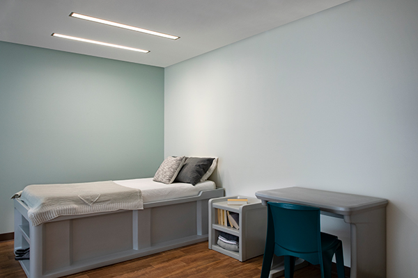 Lenga overbed luminaires for behavioral health bedrooms