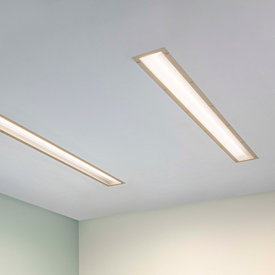 Lenga asymmetric dual overbed slot luminaires for behavioral health