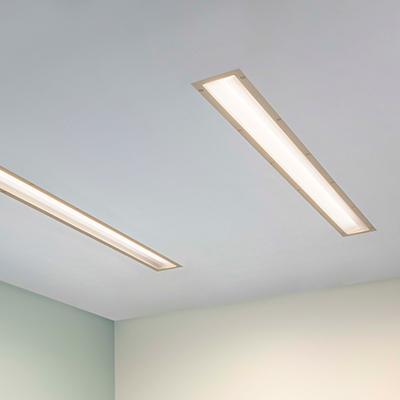 Lenga asymmetric dual overbed slot luminaires for behavioral health