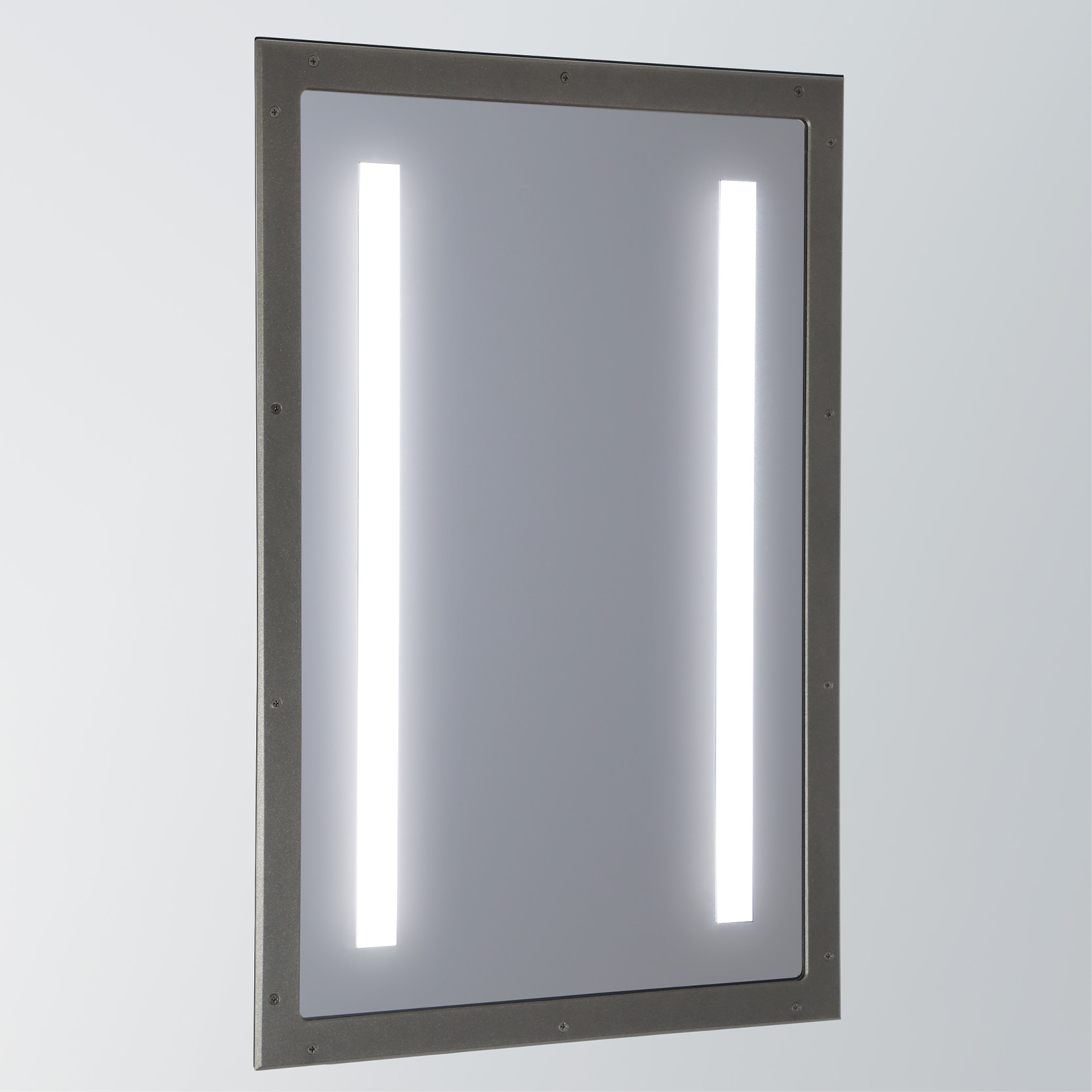 Sole, an illuminated high abuse mirror for behavioral health spaces
