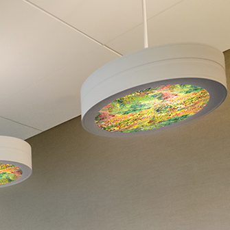 LED pendant light with Vara Kamin artwork with spring colors