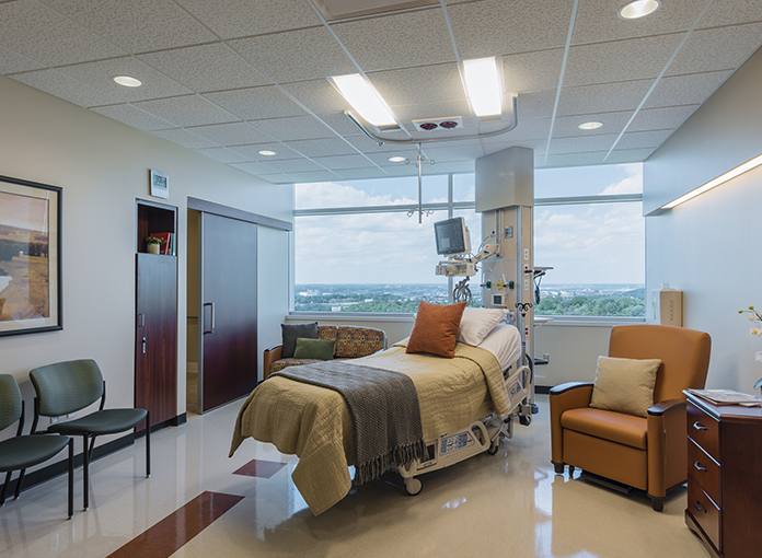 Unity tandem overbed light fixtures in a bright patient room