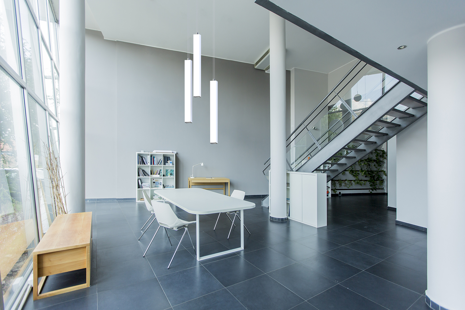 Sequence Square, a square luminous vertical pendant above a modern dining room