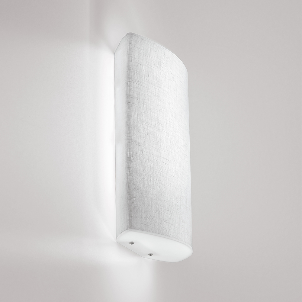 A curved square wall sconce with fabric-like diffuser