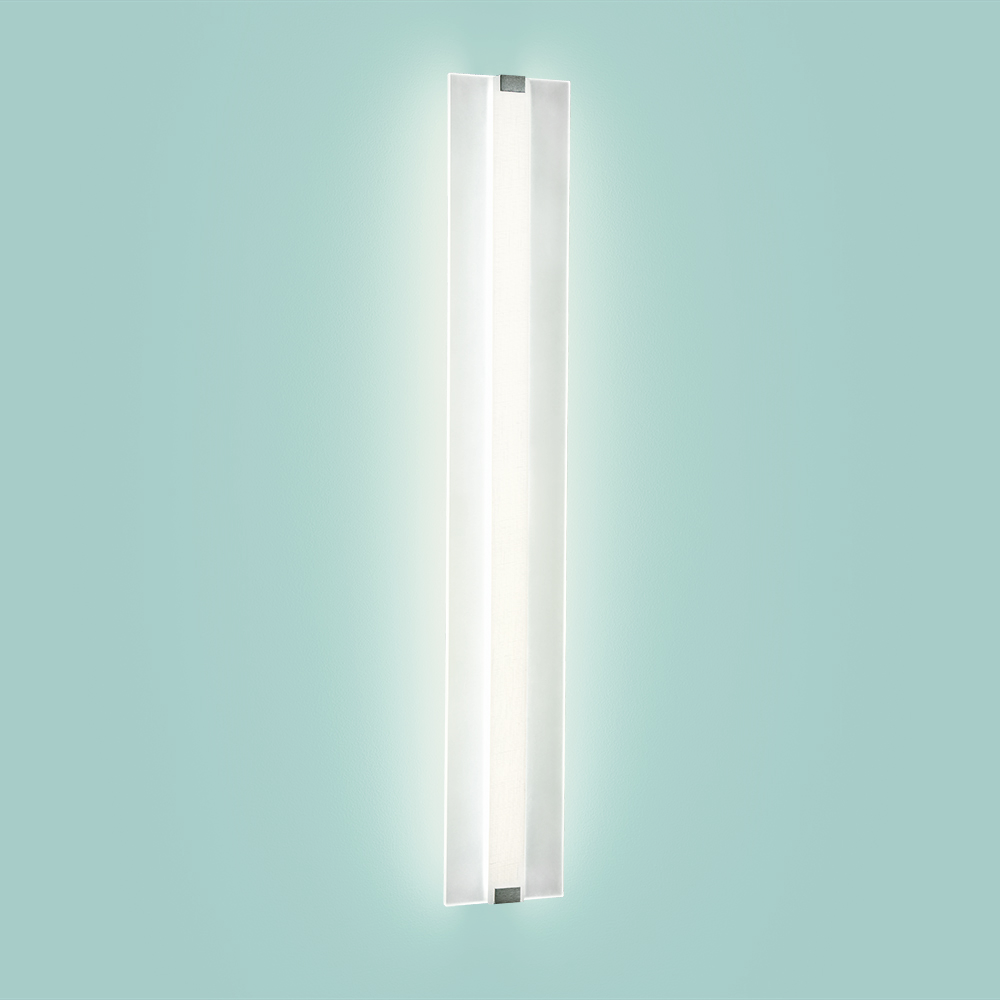 A flat linear wall sconce with a thin, luminous body and dual diffuser layers