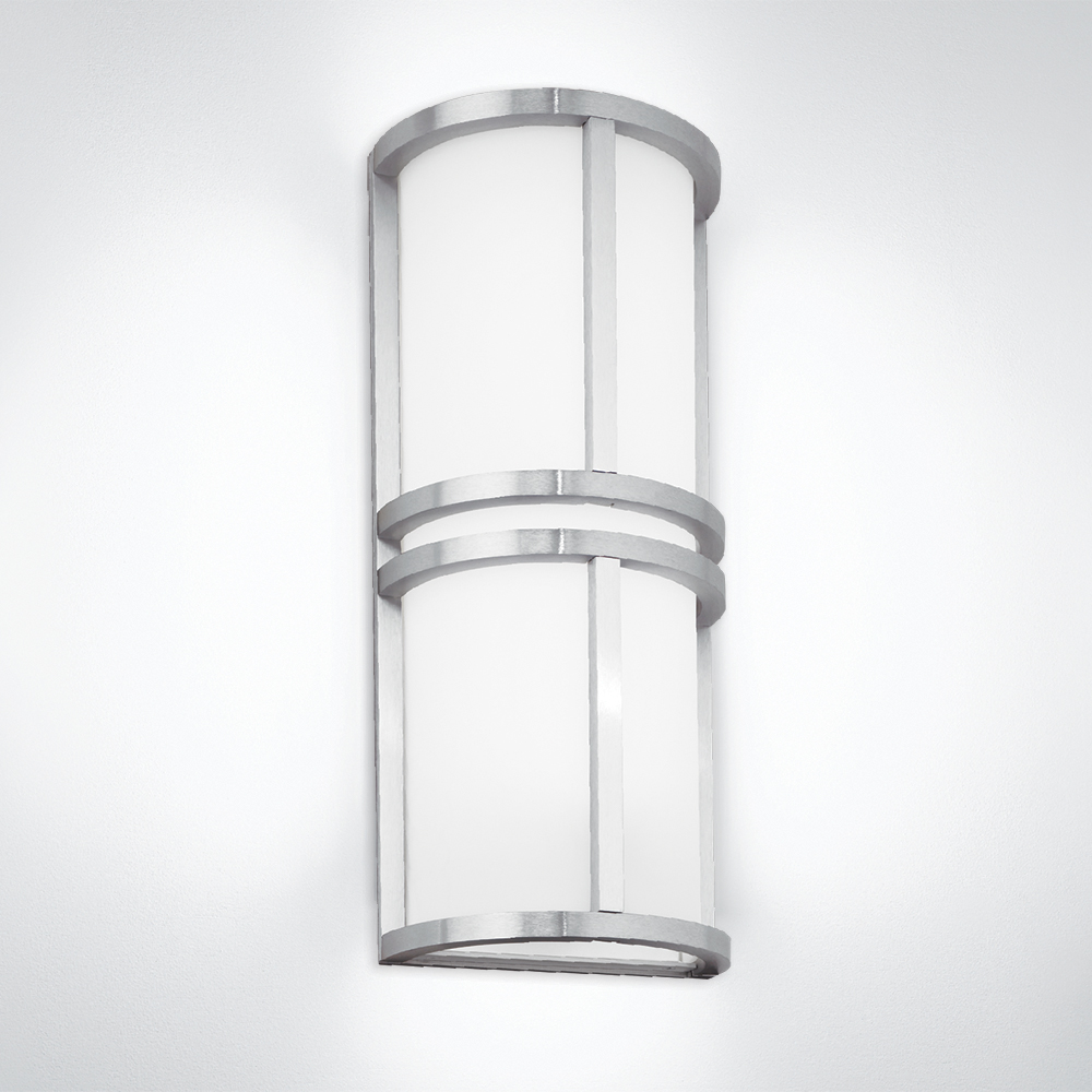A rectangular indoor wall sconce with center bar accents