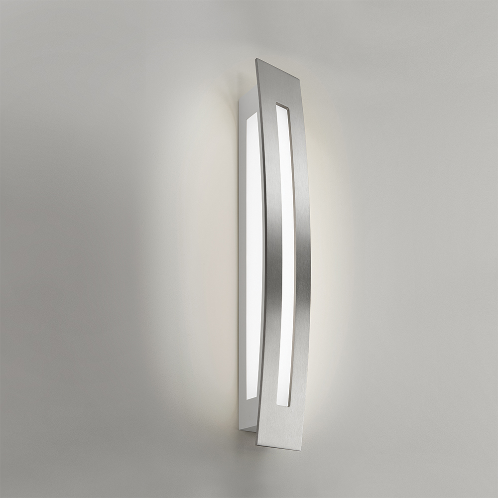 A long, multi-sided wall sconce with diffuse light cutouts