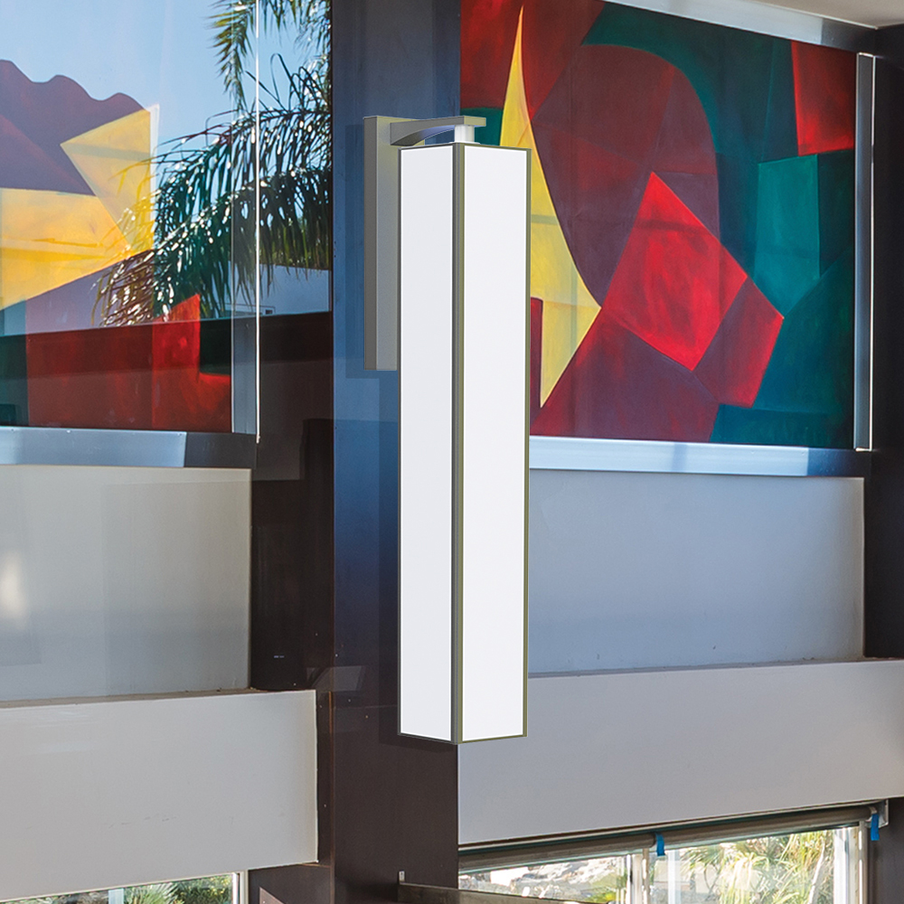 A large, rectangular wall-mounted luminaire with a frame and luminous diffuser body