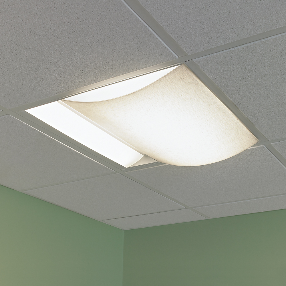 A 2x2 ceiling fixture with a curved fabric-like lens