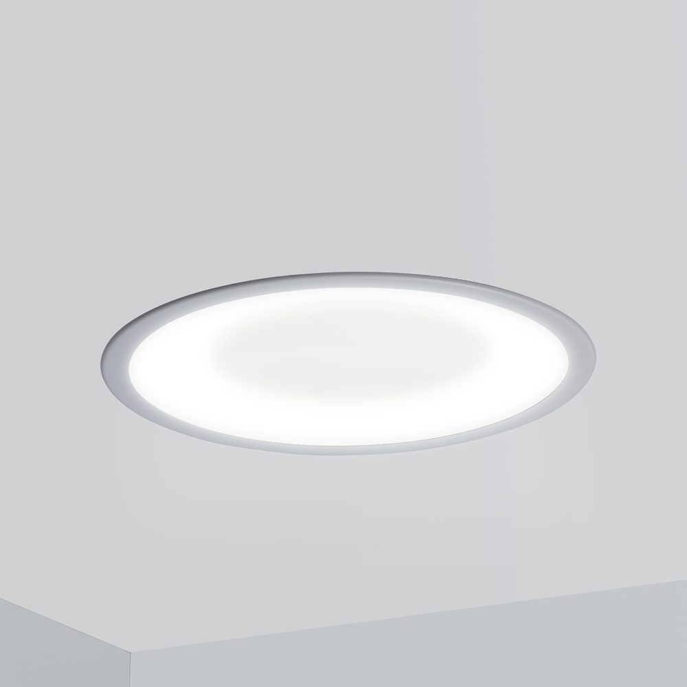 A round, recessed ceiling luminaire with a concave dome lens