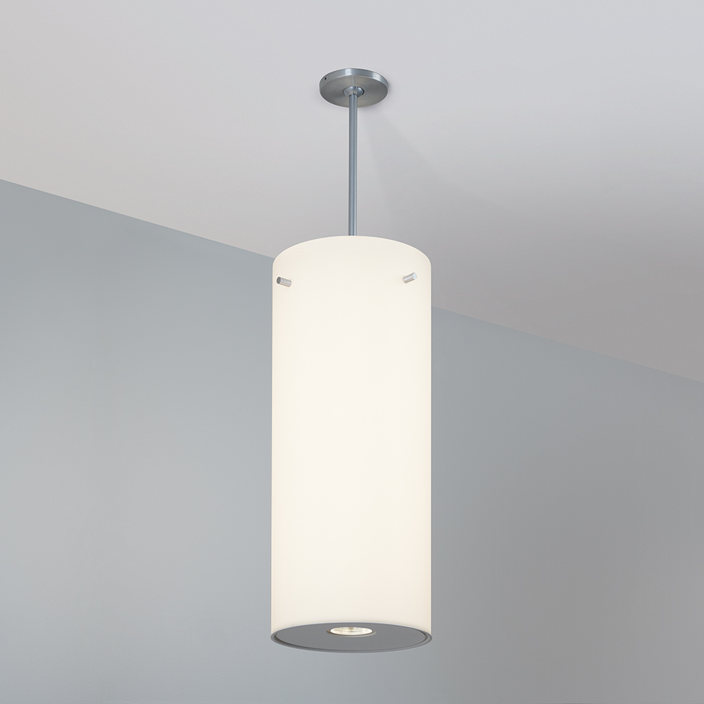 A large, luminous cylinder pendant with a pin accent