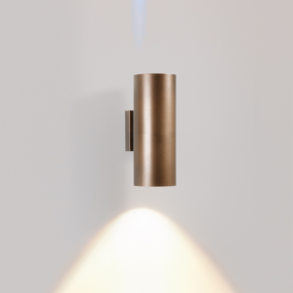 A cylindrical outdoor wall sconce with no accent