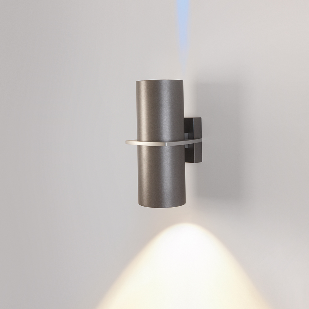 A cylindrical outdoor wall sconce with one square accent