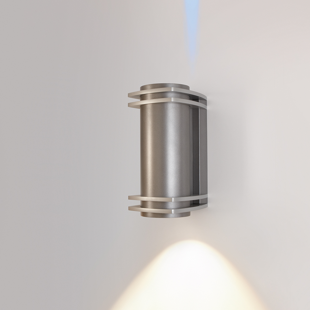 A cylindrical outdoor wall sconce with four square accents