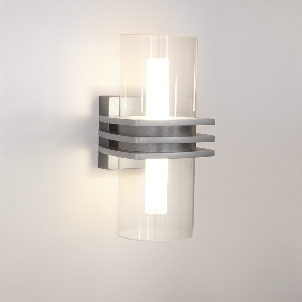 A cylindrical outdoor wall sconce with three square accents