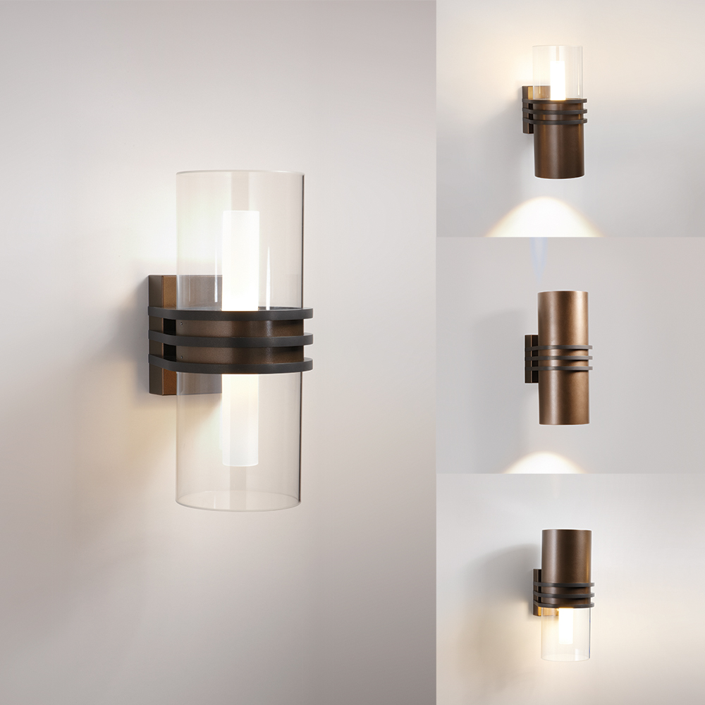 A cylindrical outdoor wall sconce with three round accents