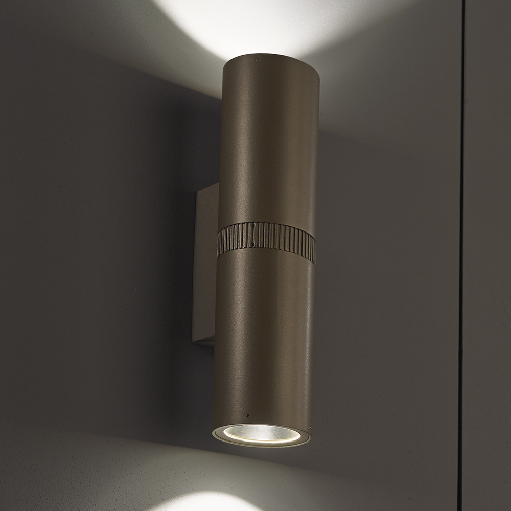 A solid cylinder wall sconce with up and downlight