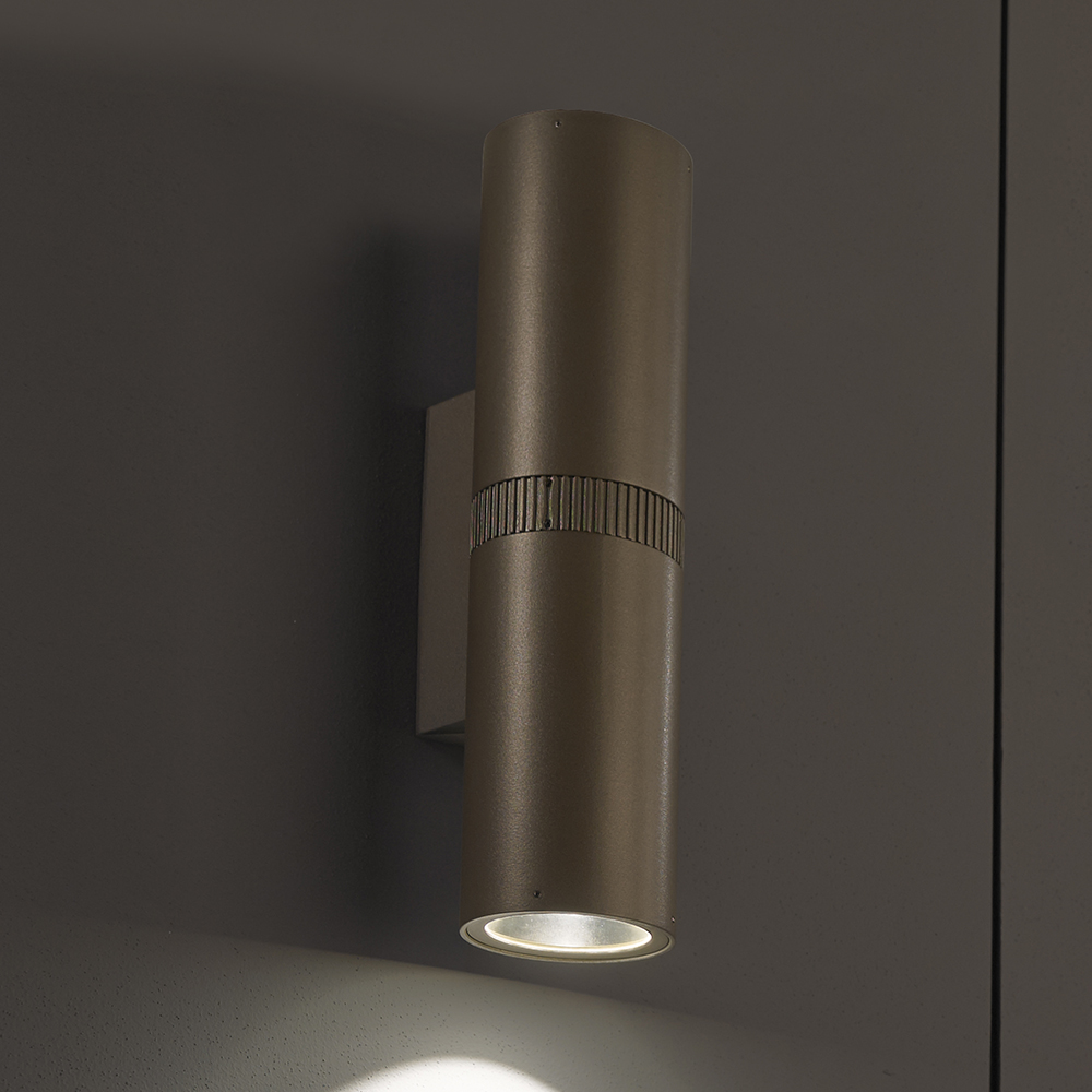 A solid cylinder wall sconce with a downlight