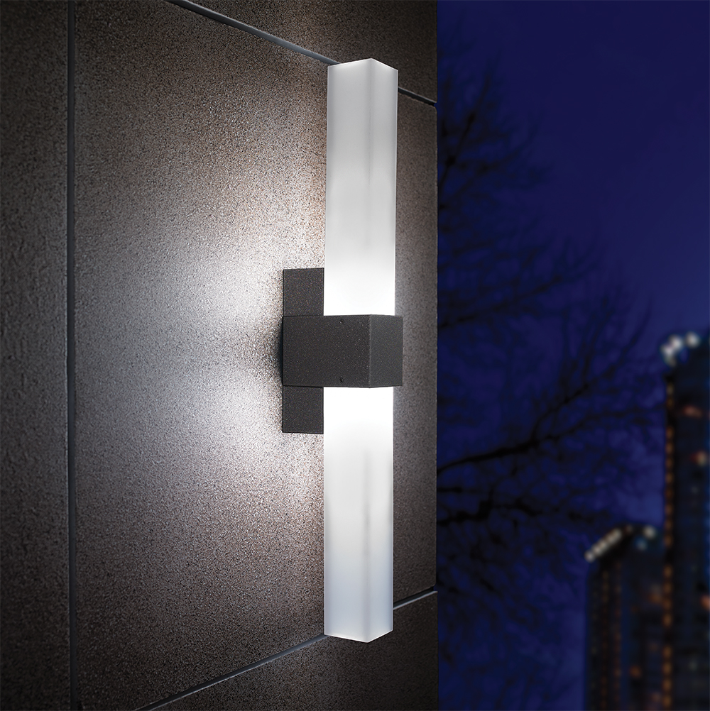 A thin outdoor wall sconce with a rectilinear diffuser body