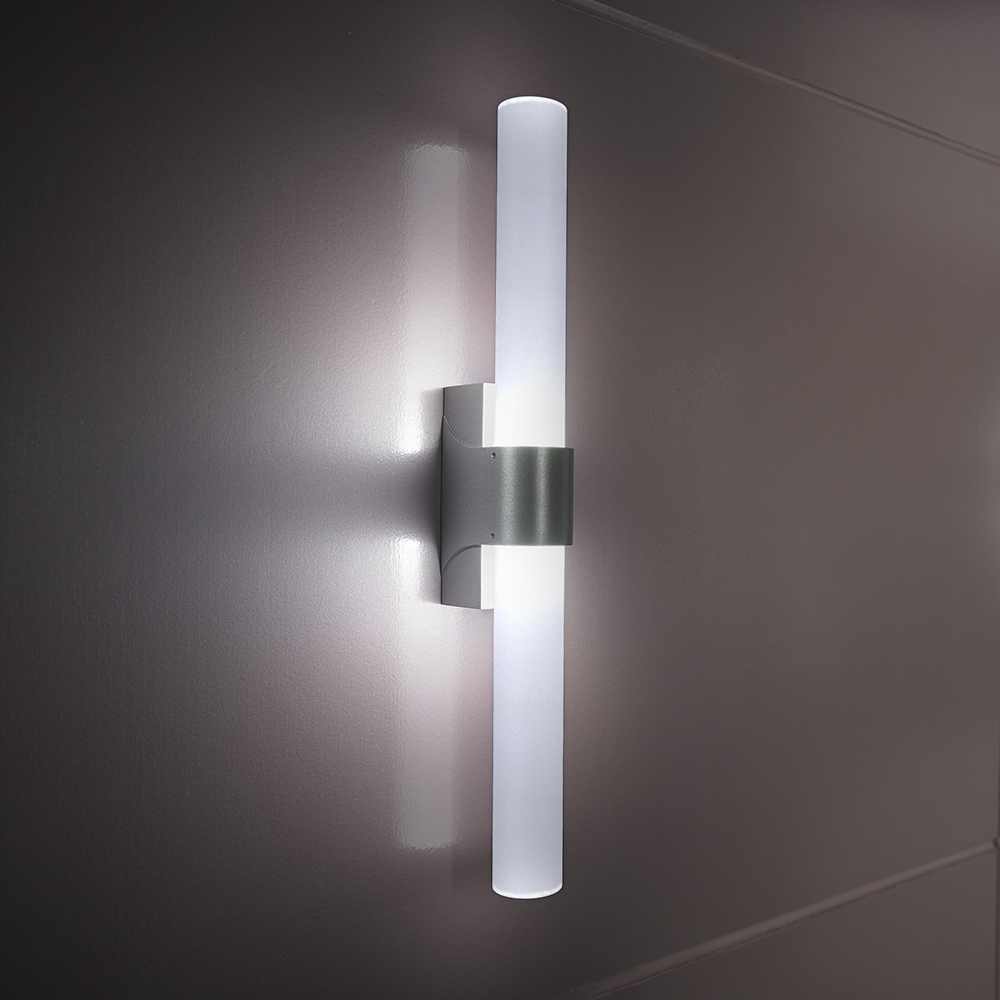 A thin, cylindrical outdoor wall sconce with a round body