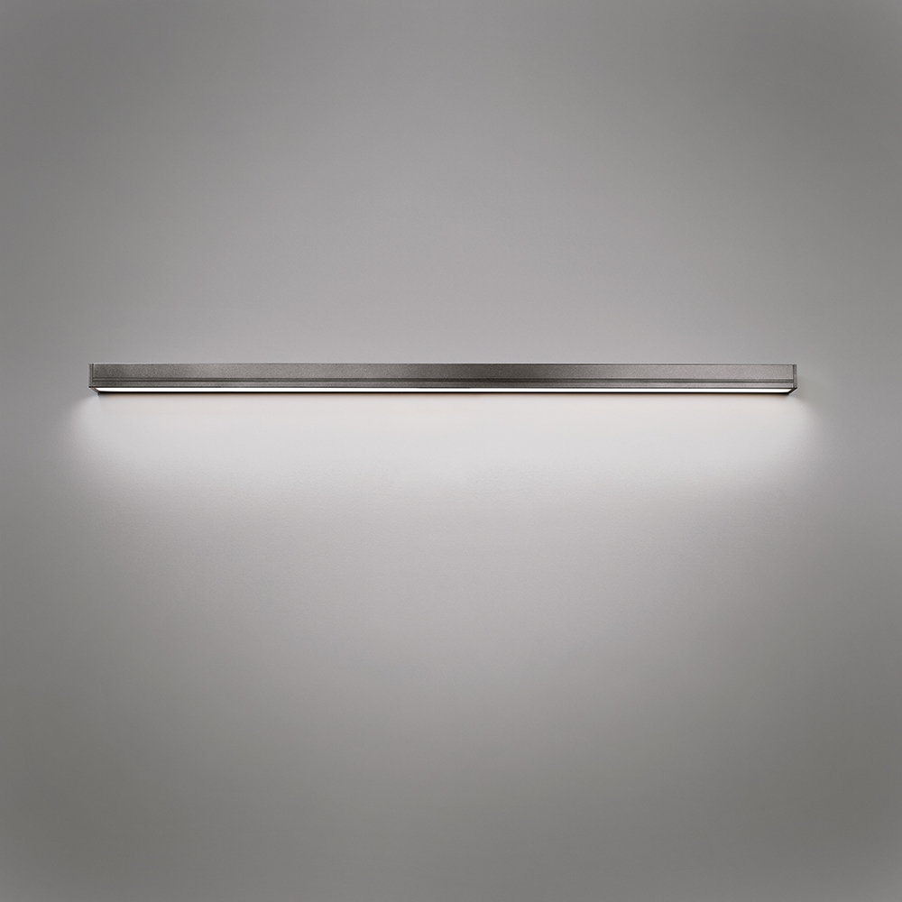 A linear indirect wall sconce for outdoor mounting