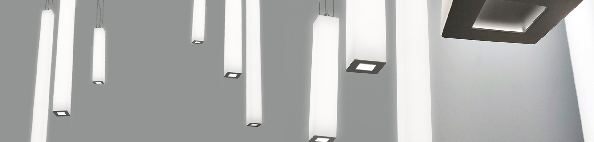 Close-up image of Sequence Square luminous cylinder pendants