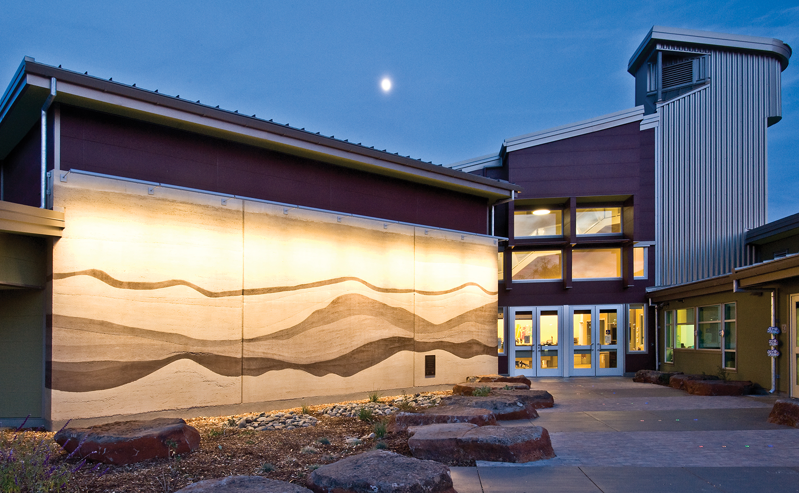 Advantus outdoor light fixtures highlight a beautiful exterior mural from above.