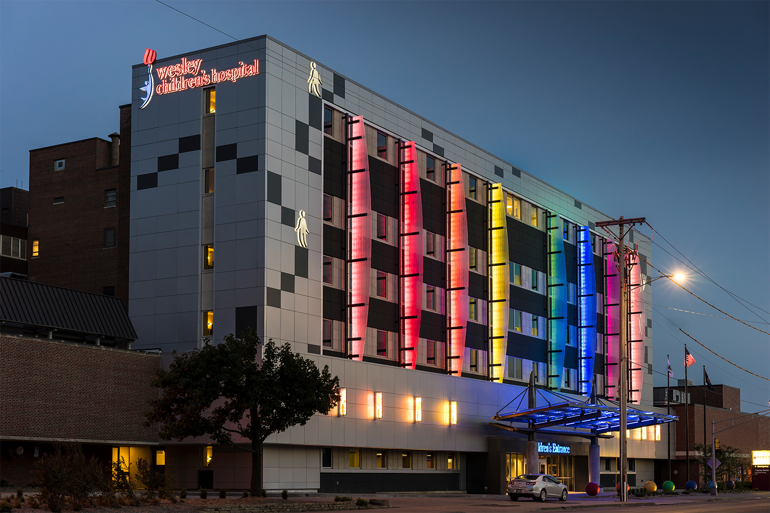 Air Foil custom light fixtures illuminate the colorful exterior of a new children's hospital.