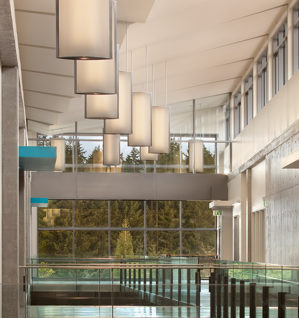 Air Foil pendants mounted along a large university lobby for stunning education design.