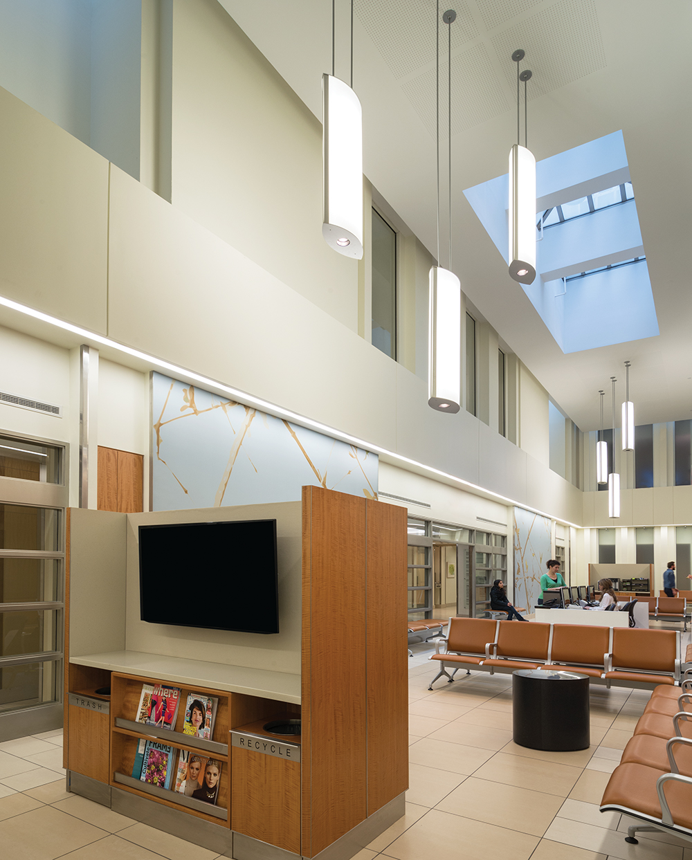Air Foil pendants hung in a large waiting room for eye-catching hospital lighting design.