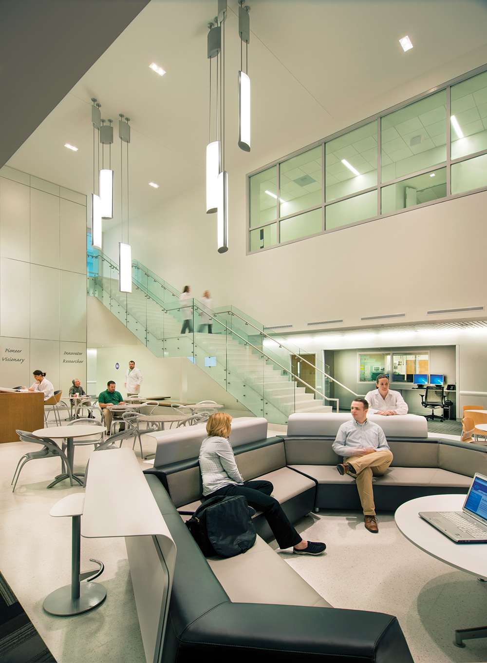 Air Foil pendants illuminate a large waiting room for a modern hospital lighting application.