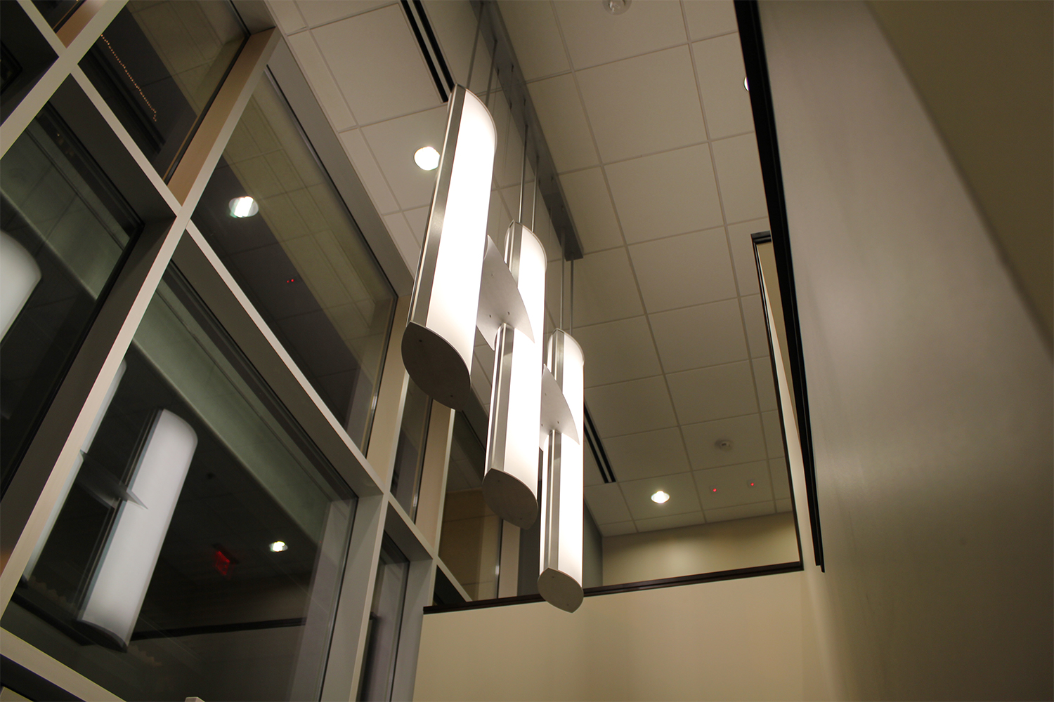 Air Foil pendants hung in a group of three for a stylish hospital lighting design.