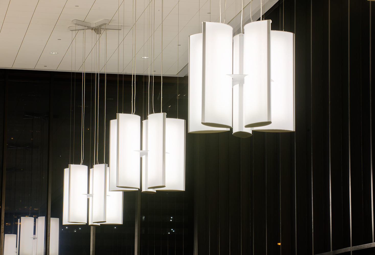 Air Foil pendants in a lobby lighting configuration, each cluster a group of five elliptical panels.