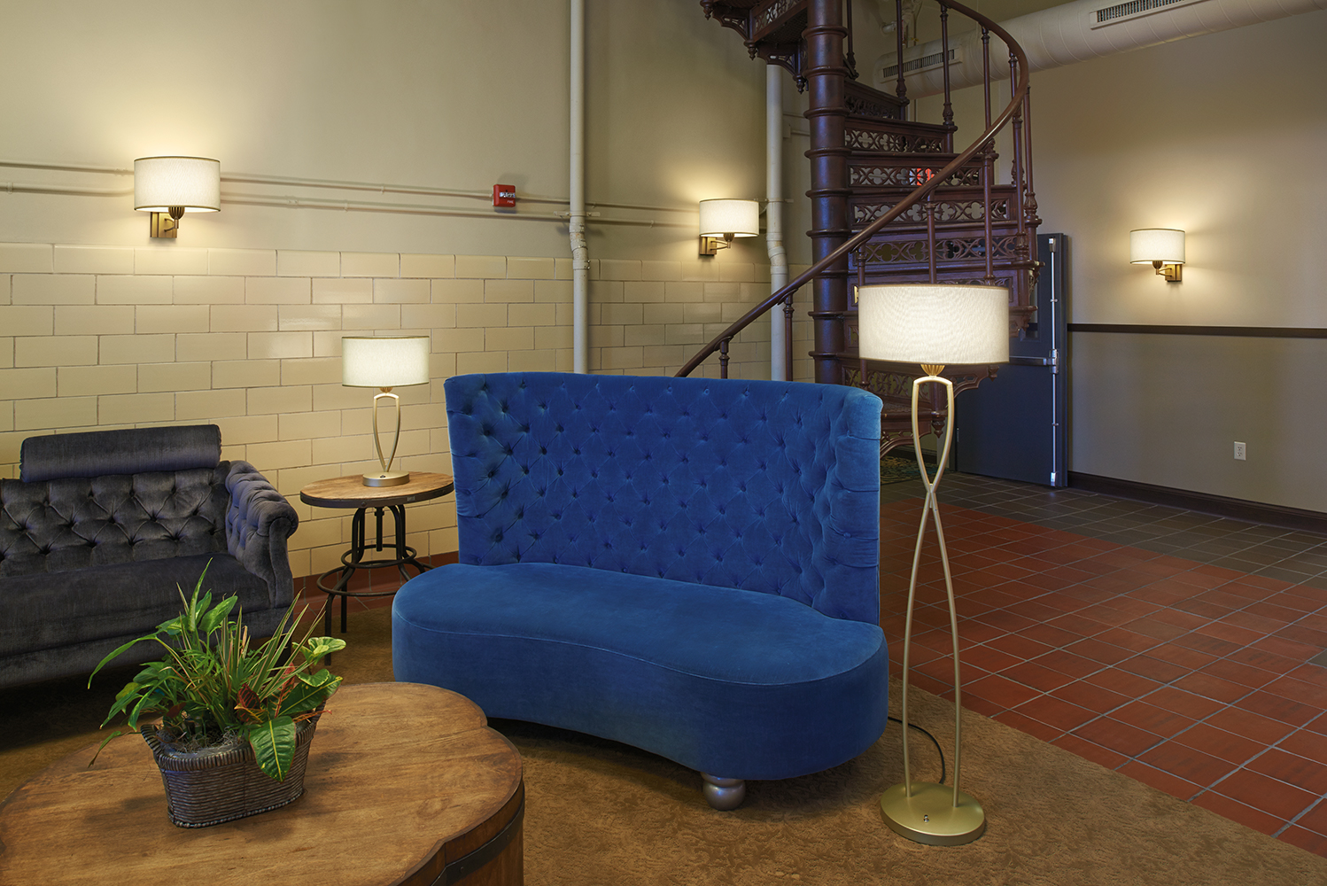 Allegro portable luminaires and wall sconces provide a soft glow in a common room for multifamily design applications.